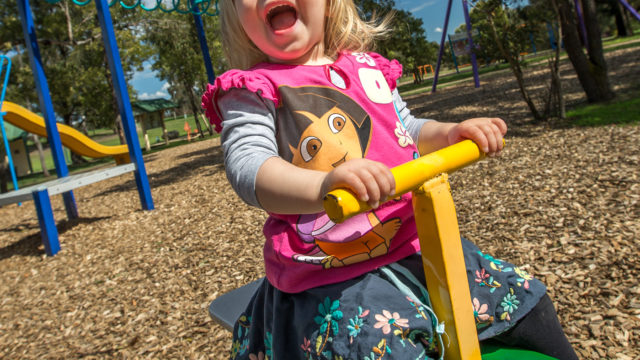 child-on-swing-at-Newman-Park-playground-Traralgon