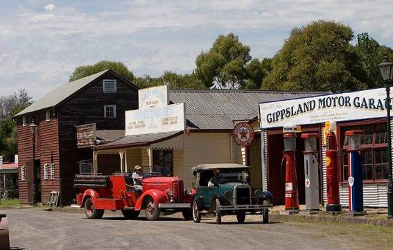 old cars and buildings in Old Gippstown Heritage Park Museum Moe