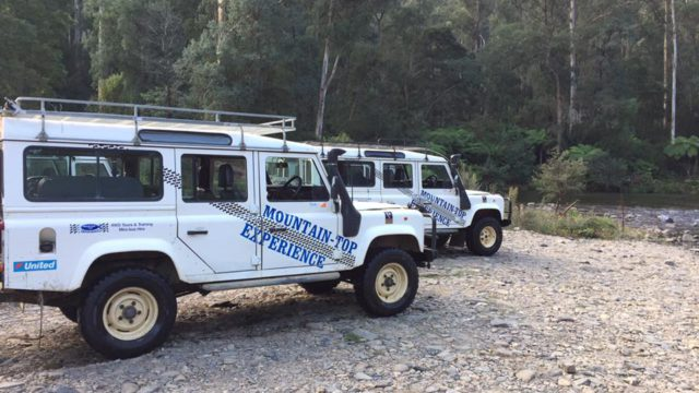 beside a river with mountain top tours 4WD