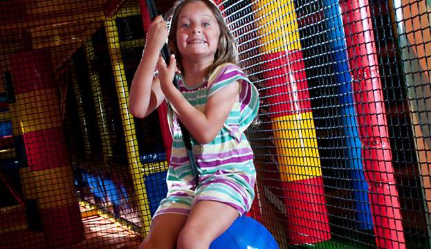 kid-swinging-playing-at-parkys-fun-park-play-centre-traralgon